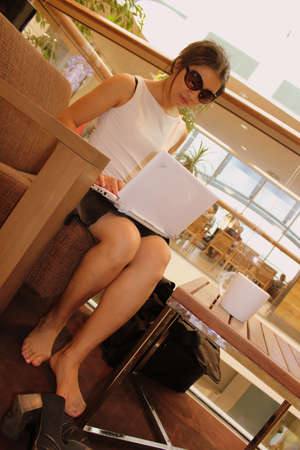 Asian business woman working in a cafe on her laptop photo