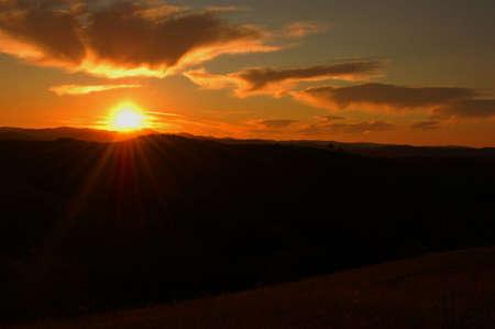 ridges: sunrise over the mountains, meadows, ridges Romanian
