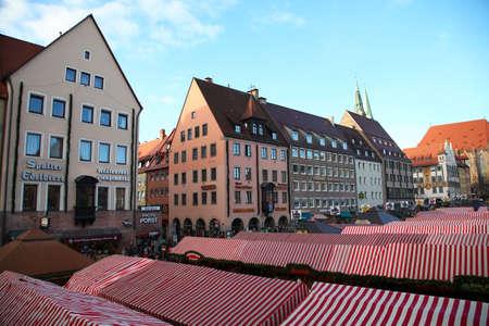 christkindlesmarkt: NUREMBERG, GERMANY - DECEMBER 23, 2013: The most famous Christmas Fair in Germany Christkindlesmarkt in Nuremberg, Germany