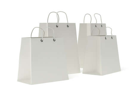handles: four classic white blank shopping bags with handles isolated on white. (3d render)