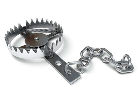 Metal animal trap open. Attached to the ground with a metal chain