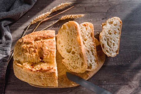 Various rustic bread on a wooden board. Healthy food and farming concept Stok Fotoğraf