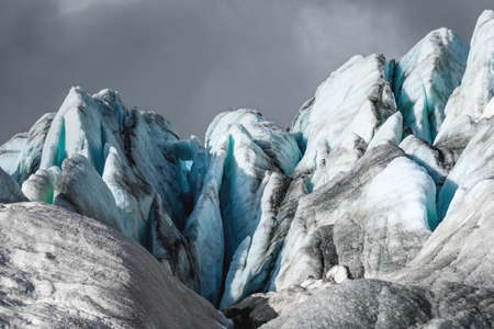 Blue icy peaks high in the mountains. The concept of mountain climbing and extreme recreation Stok Fotoğraf