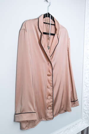 Beautiful nightwear pajamas hang on a hanger. The concept of clothes for sleep and relaxation