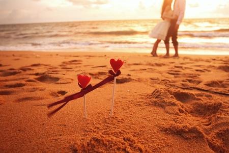 valentine s day beach: Amorous couple under an umbrella