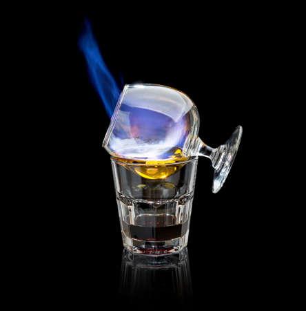 flaming: flaming sambuca cocktail on a black background