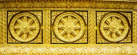 shakti: golden buddhism wheel of the dharma Stock Photo