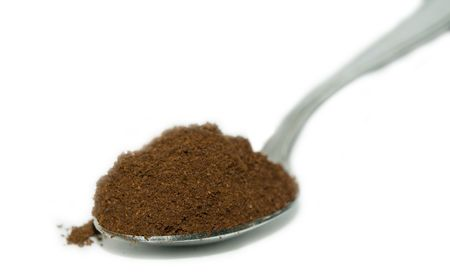 milled: Milled coffee in a spoon Stock Photo