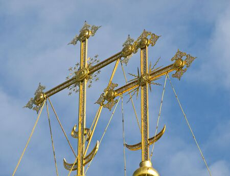 christcross: Domes of church against the blue sky in the autumn