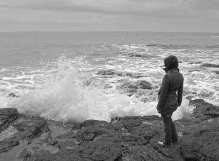 sputter: Woman on the ocean coast