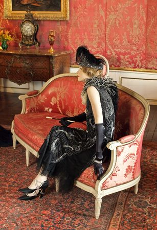 Aristocratic woman sitting in castle hall photo