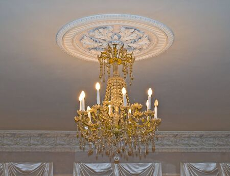 slings: Gold chandelier in old house