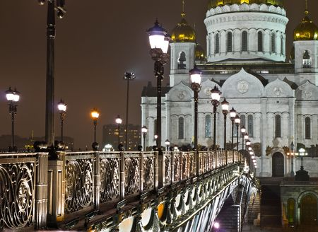 Cathedral of Christ the Saviour in Moscow night view with bridge photo