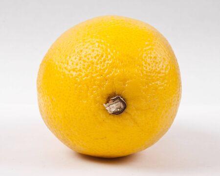 fruited: Yellow lemon on white background