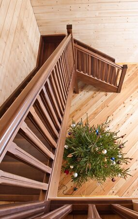 Wooden staircase in country house photo