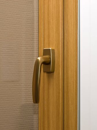 Window handle on fiberglass window. Gold color. Stock Photo - 7761002