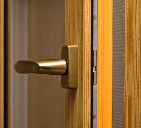 Window handle on fiberglass window. Gold color. Stock Photo - 7761011