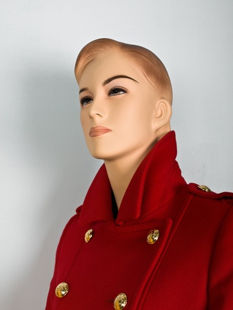 Red coat on mannequin in shop photo