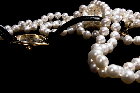 costly: Pearl beads with female gold watch