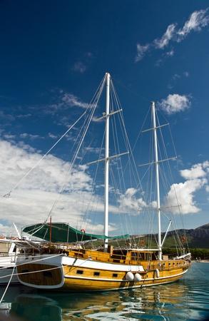 brig ship: Old fashioned yacht sunny evening on quae