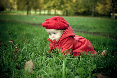 Pretty little girl lying in the green grass Stock Photo - 10858956