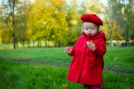 discovering: Little child discovering the world in autumn park Stock Photo