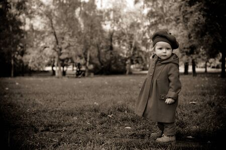 Little child discovering the world in autumn park Stock Photo
