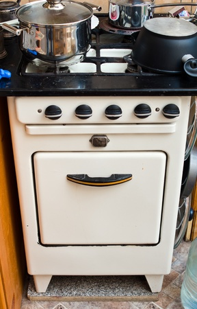 gas stove: Old but useful gas stove in the kitchen Stock Photo