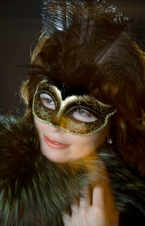 Young woman portrait with venetian mask photo