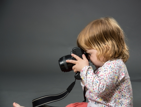 Little child with mirror photo camera