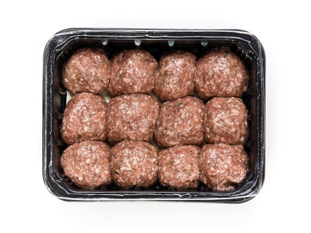 Flesh meat product for cooking packed in box isolated on white photo