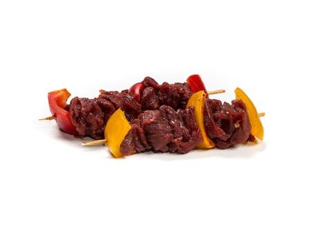 Fresh flesh meat shashlik with vegetables isolated on white Standard-Bild