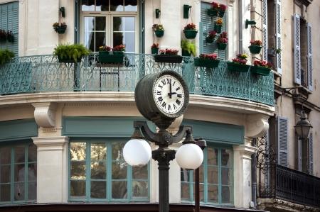 Retro style street clock with lantern in Avignon France Stock Photo - 16761646