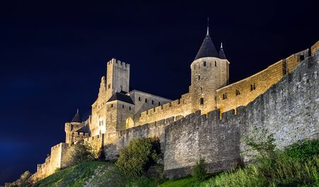 restoring: Carcassone medieval castle night view. Languedoc, France.