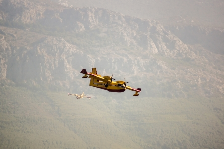 dampen: Fire fighter plane over the mountains. Croatia.