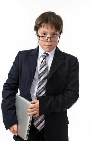 Sure teenage boy with laptop. Elegance and style. Stock Photo