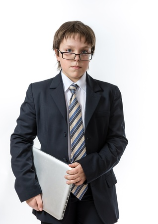 Sure teenage boy with laptop. Elegance and style. Stock Photo - 18036297