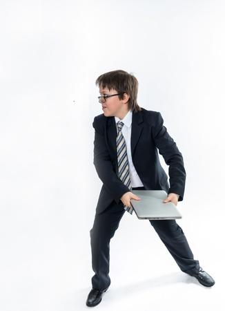 fling: Elegant teenage boy throws laptop. Rage and expression.