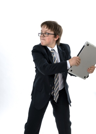 Elegant teenage boy throws laptop. Rage and expression. Stock Photo - 18035751