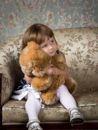 Cute little girl portrait in studio with teddy-bear