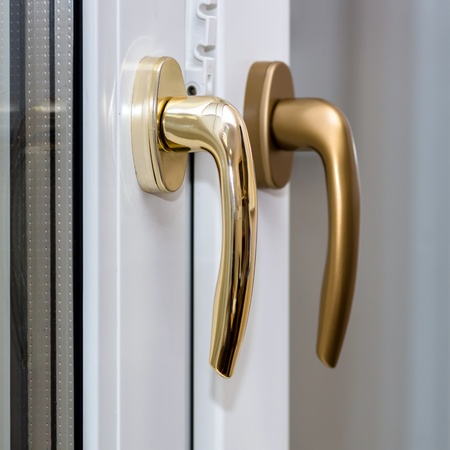 Window handles on plastic window. Gold color. PVC. Stock Photo - 19456133