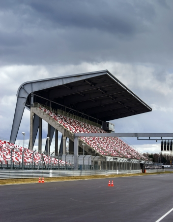tribune: Giant tribune with colorized seats on Formula 1 track Editorial