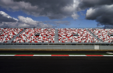 Giant tribune with colorized seats on Formula 1 track Redactioneel