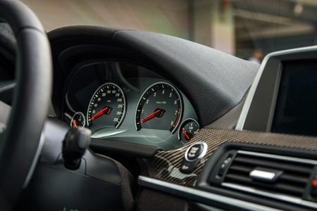 Luxury car dashboard view. Inside vehicle.