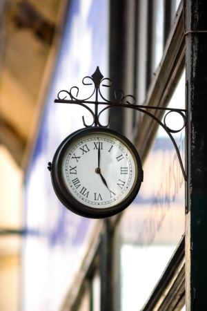 Vintage style street clock view. Center of Budapest, Hungary. Stock Photo - 20097112