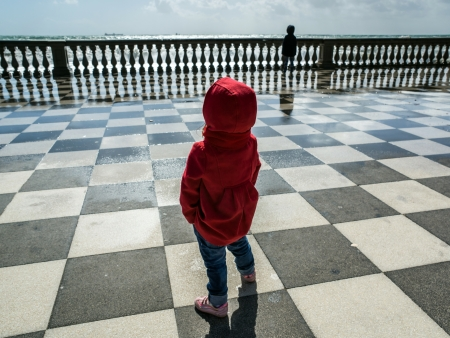 Little child looking at sea photo