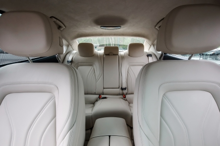Ivory color luxury town car passengers interior. Stock Photo