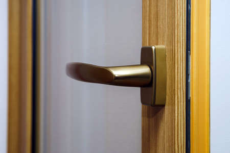 Window handle on fiberglass window. Gold color. Interior design. photo