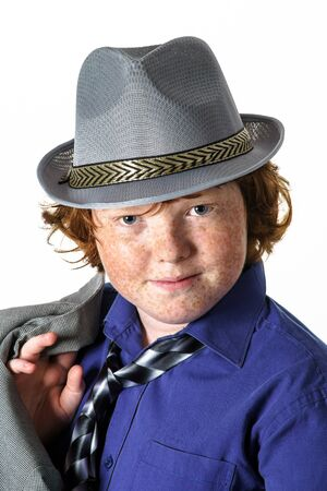 carroty: Freckled red-hair boy portrait in hat. Teenager age. Stock Photo
