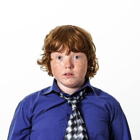 freckled: Freckled red-hair boy emotion portrait. Isolated on white background. Stock Photo